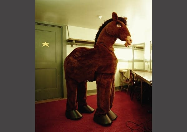 2 People Wearing a Horse Costume In a Dressing Room