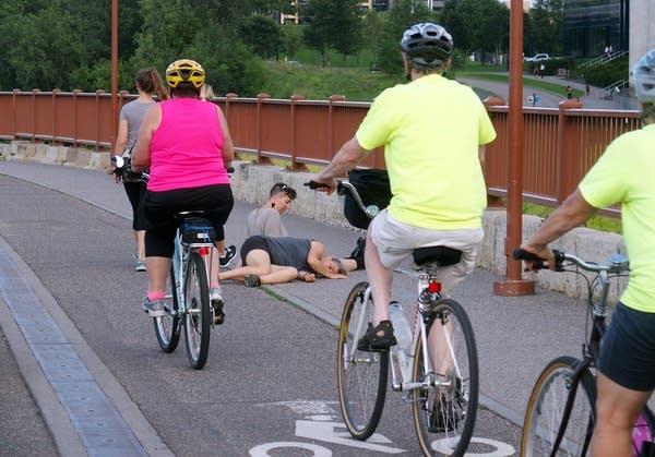 Cyclists rode past dancer Olive Bieringa.