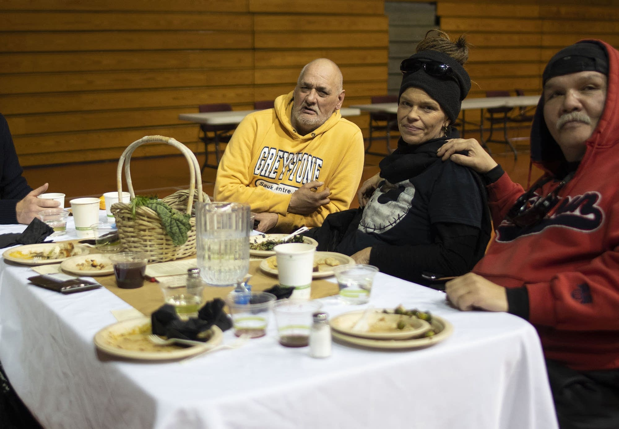 Residents of the navigation center gather for a community feast.