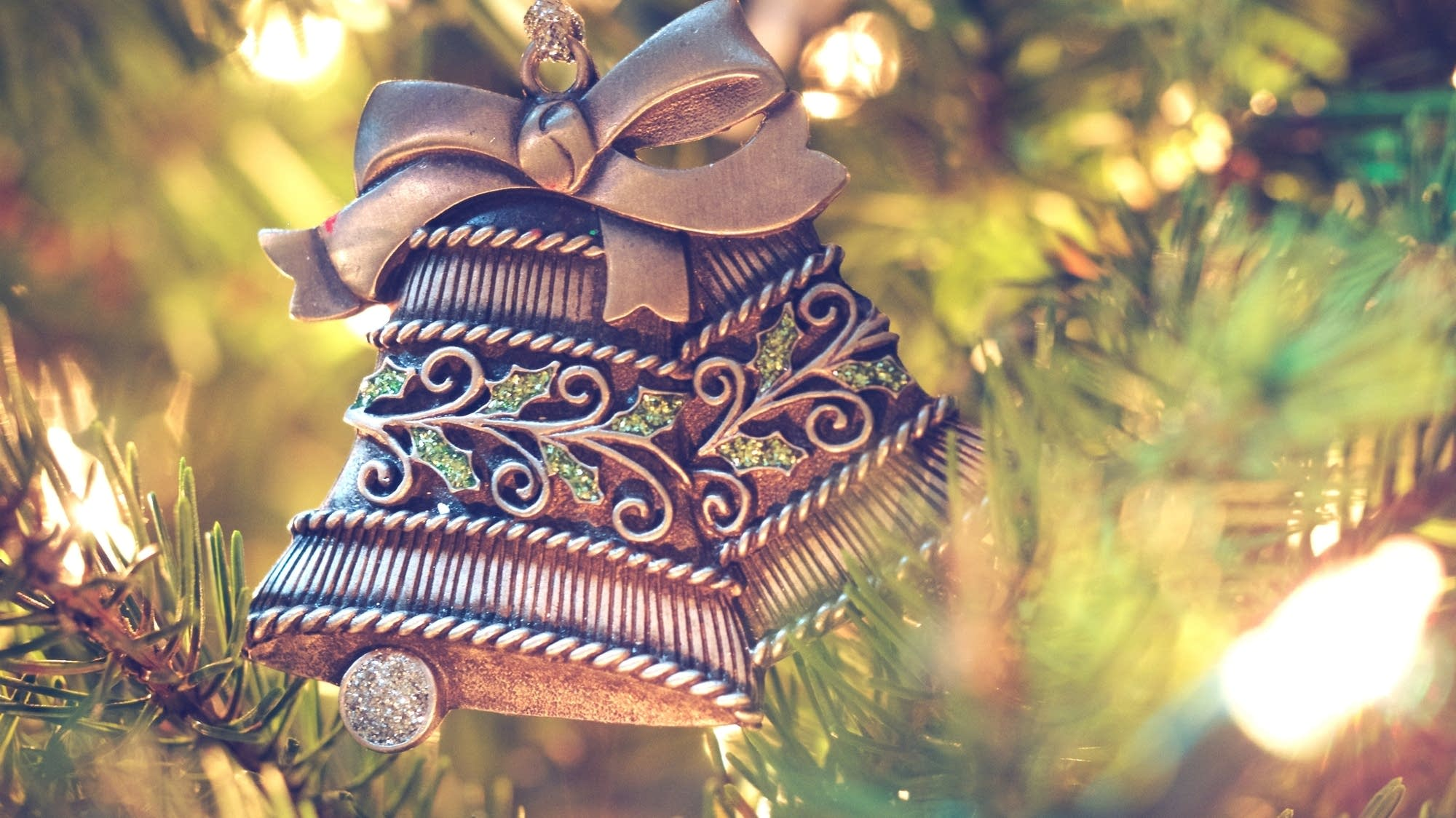 Bell ornaments decorate a tree.