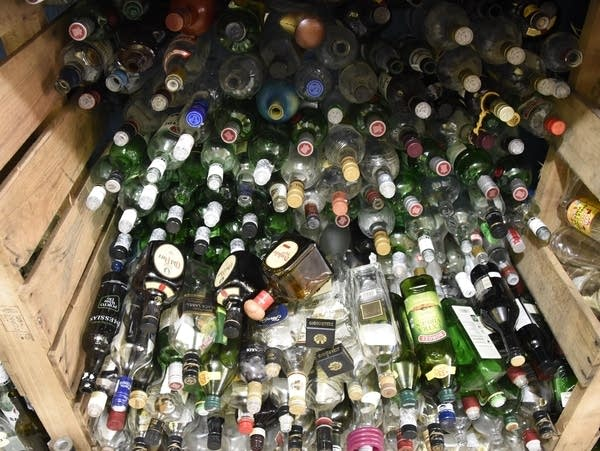 A crate full of glass bottles