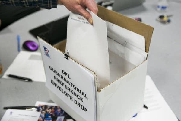A caucus convener delivers his precinct's votes