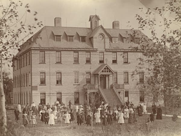 an historic photo of a large brick building