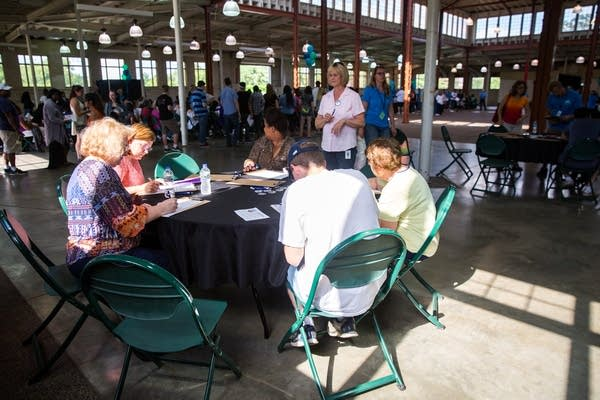 Filling out applications at the State Fair's first job fair