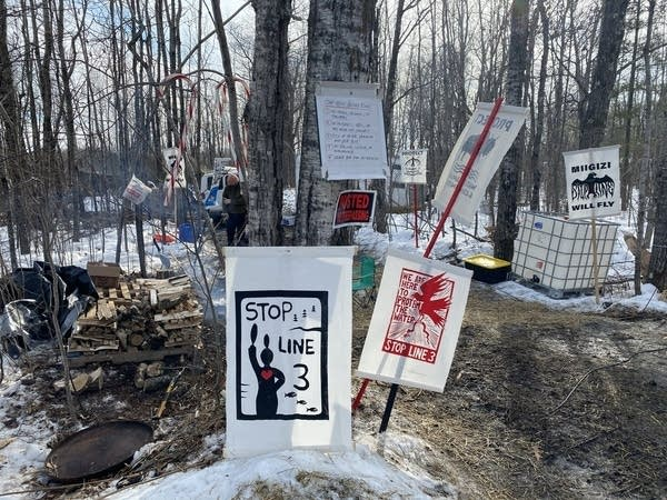 Signs greet visitors to Camp Migizi.