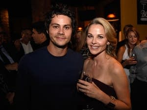 Dylan O'Brien poses for a photo with Lysa Flynn, wife of Vince Flynn.