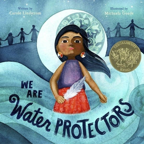A book jacket that reads, 'We Are Water Protectors'
