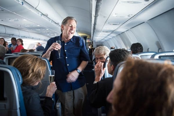 Champagne toasts ad the orchestra headed to Cuba.