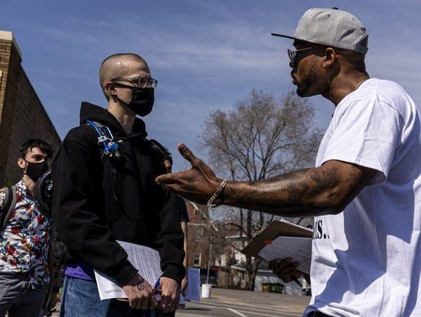 Antonio Williams (right) trains volunteer canvassers