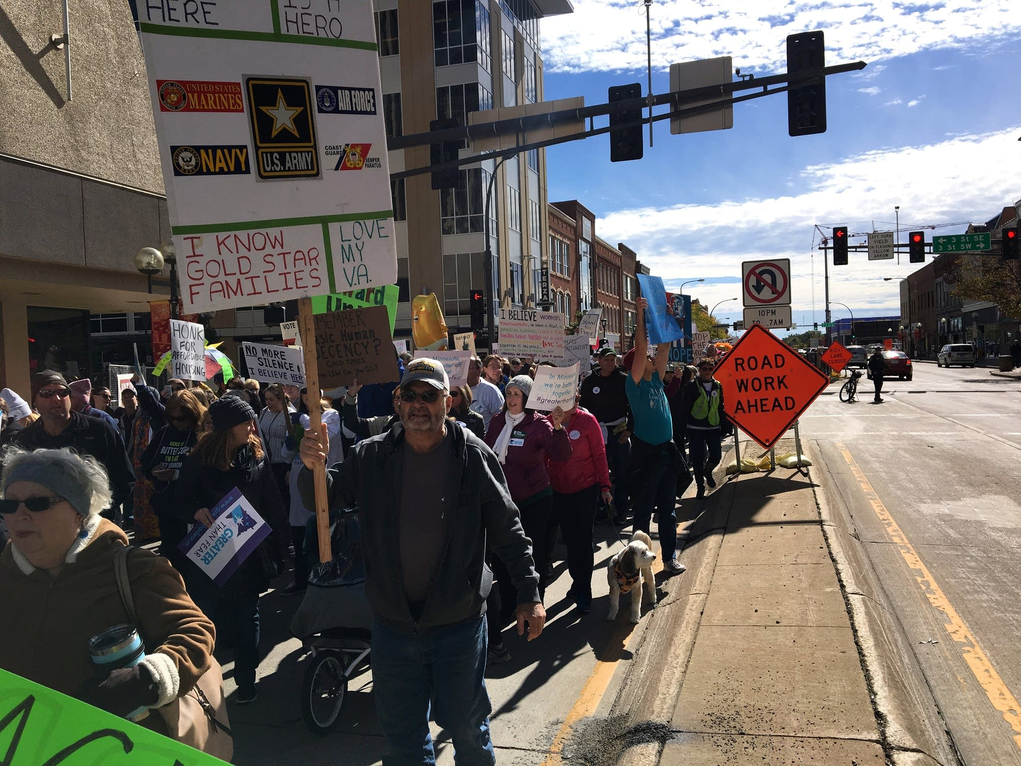 A long line of protesters marches through downtown Rochester
