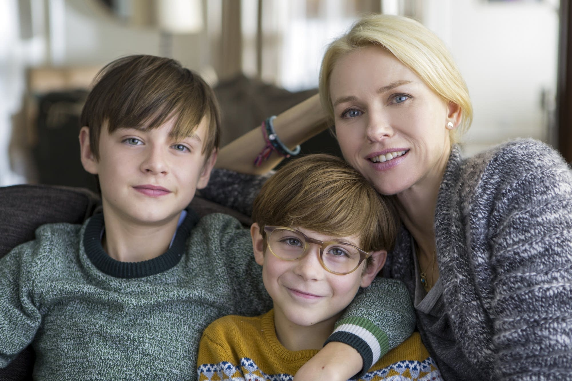 Jaeden Lieberher as Henry, Jacob Tremblay as Peter and Naomi Watts as Susan