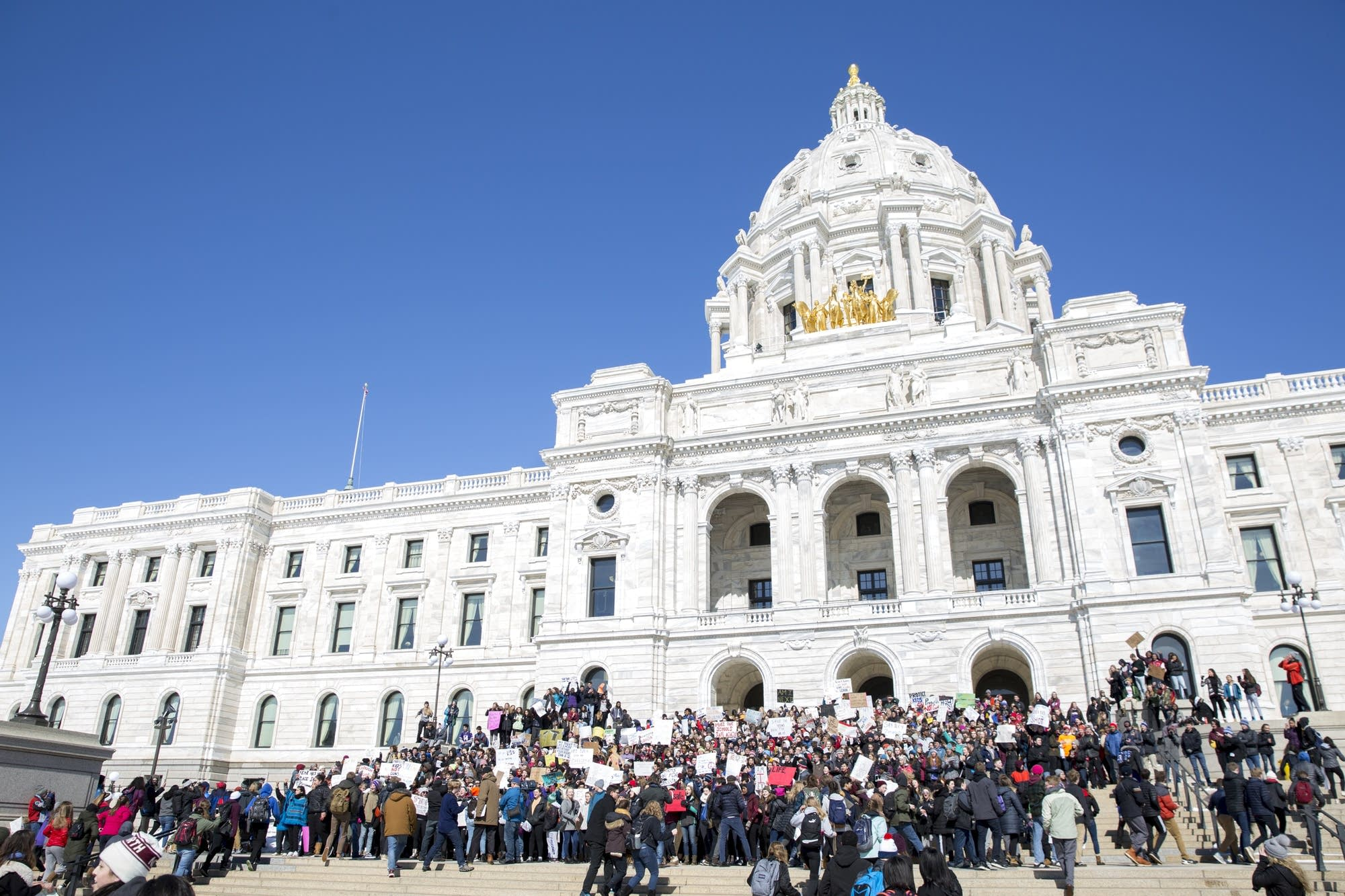 Hundreds of high school students occupy the steps of the State Capitol