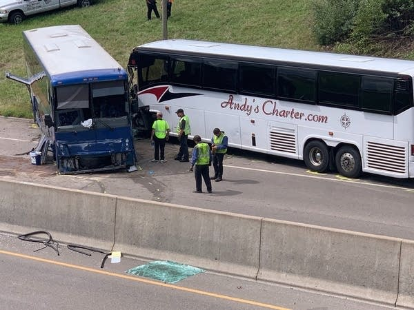 Two buses after they crashed with officials nearby