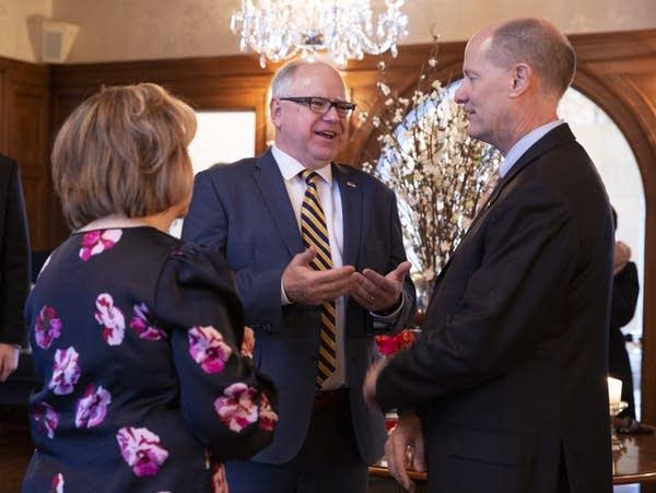 Gov. Tim Walz and his wife Gwen greet Senate Majority Leader Paul Gazelka.