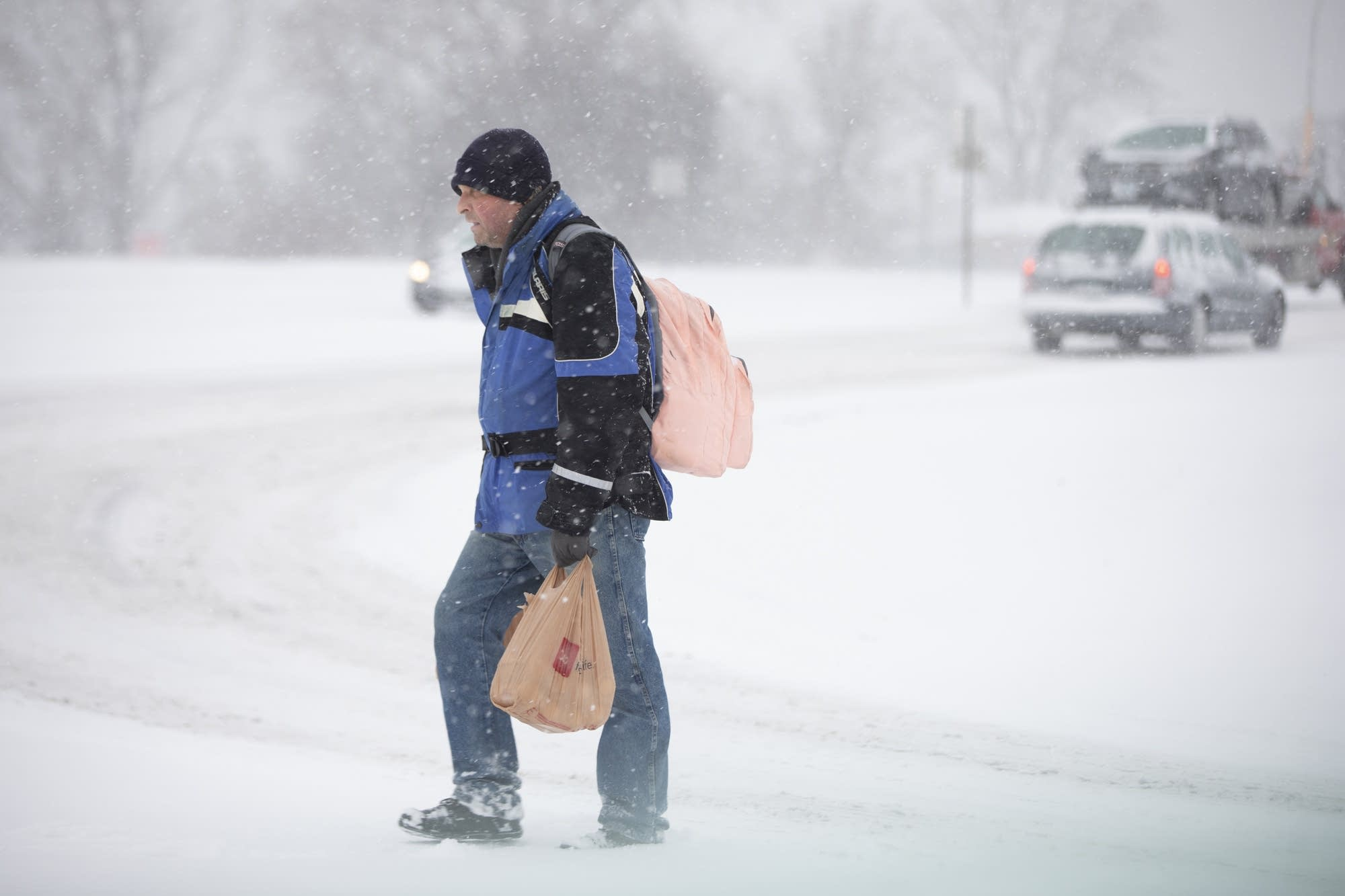 A man carrying groceries from Cub Foods in Burnsville.