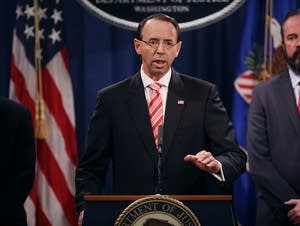 Deputy Attorney General Rod Rosenstein, at lectern