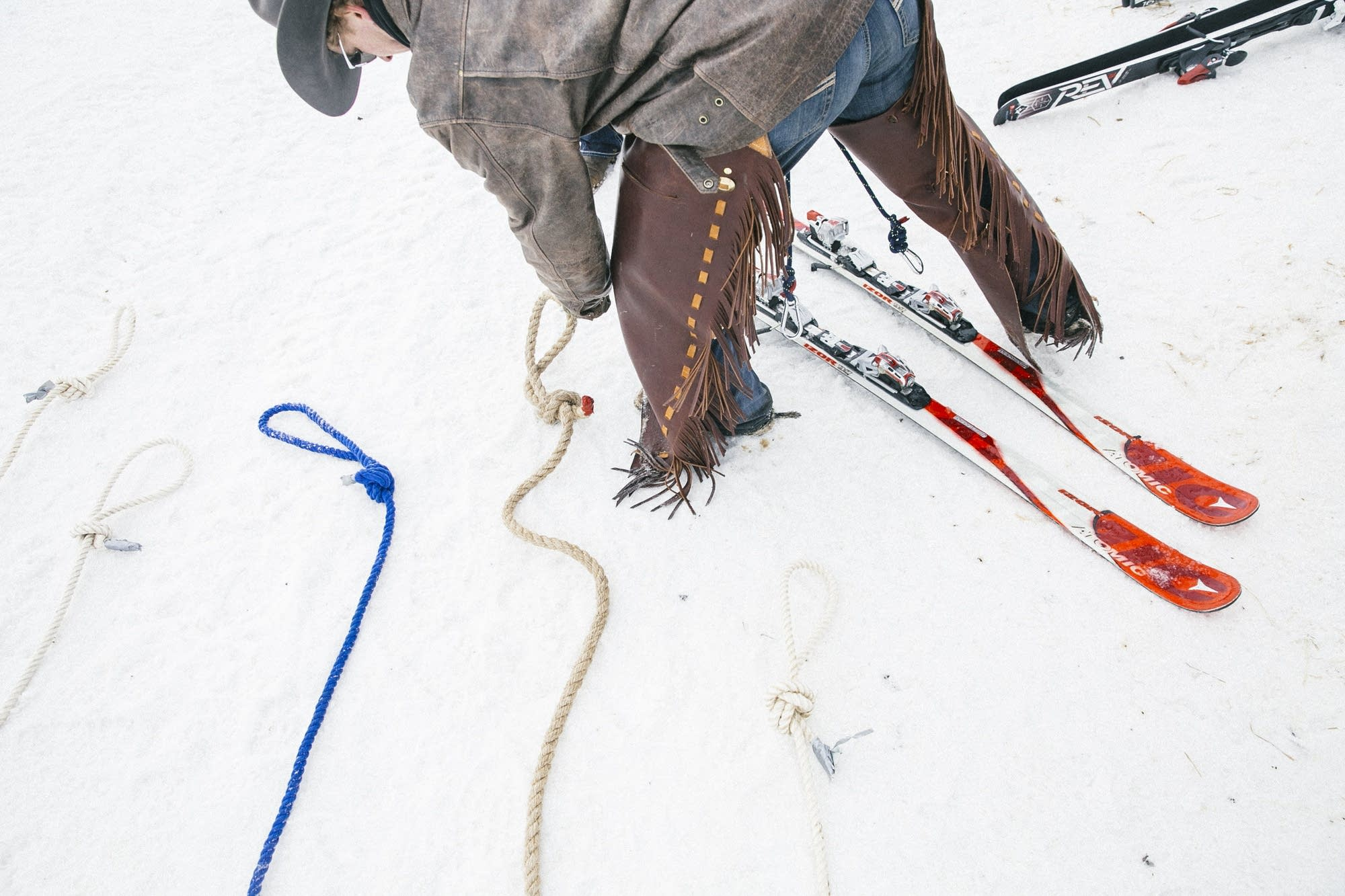 A racer lays out ropes that will pull skiers down a track full of jumps.