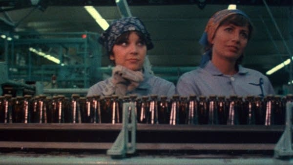 Characters Laverne & Shirley in a bottling plant from opening of the show
