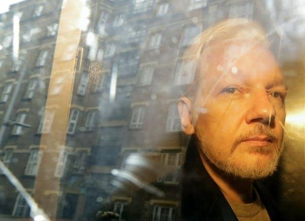 WikiLeaks founder Julian Assange is taken from court.