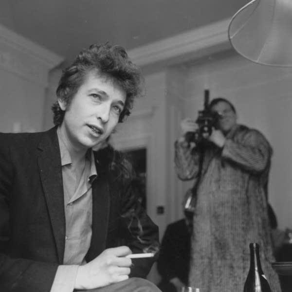 A cameraman films American folk-rock singer Bob Dylan