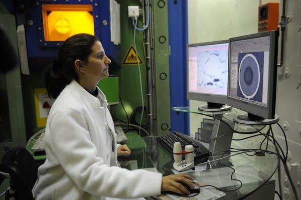 An engineer analyzes radioactive nuclear