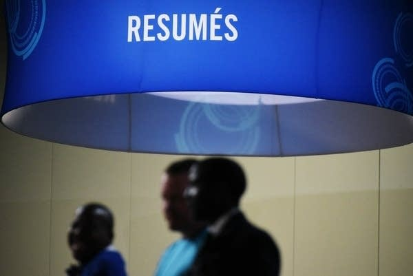 Job seekers arrive at a job fair in Washington in September 2017.