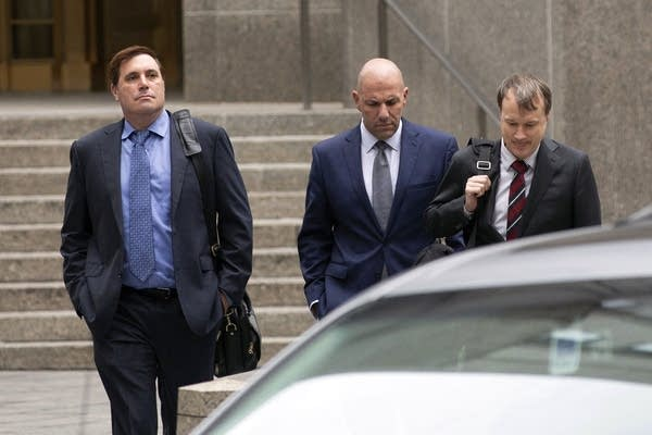 David Correia, center, arrives with his lawyers at federal court.
