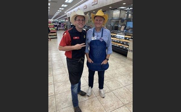 Luke Burbank and Buc-ee's employee wearing cowboy hats & apron in store