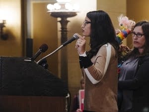 Rep. Erin Maye Quade speaks to a crowd at the Minnesota State Capitol