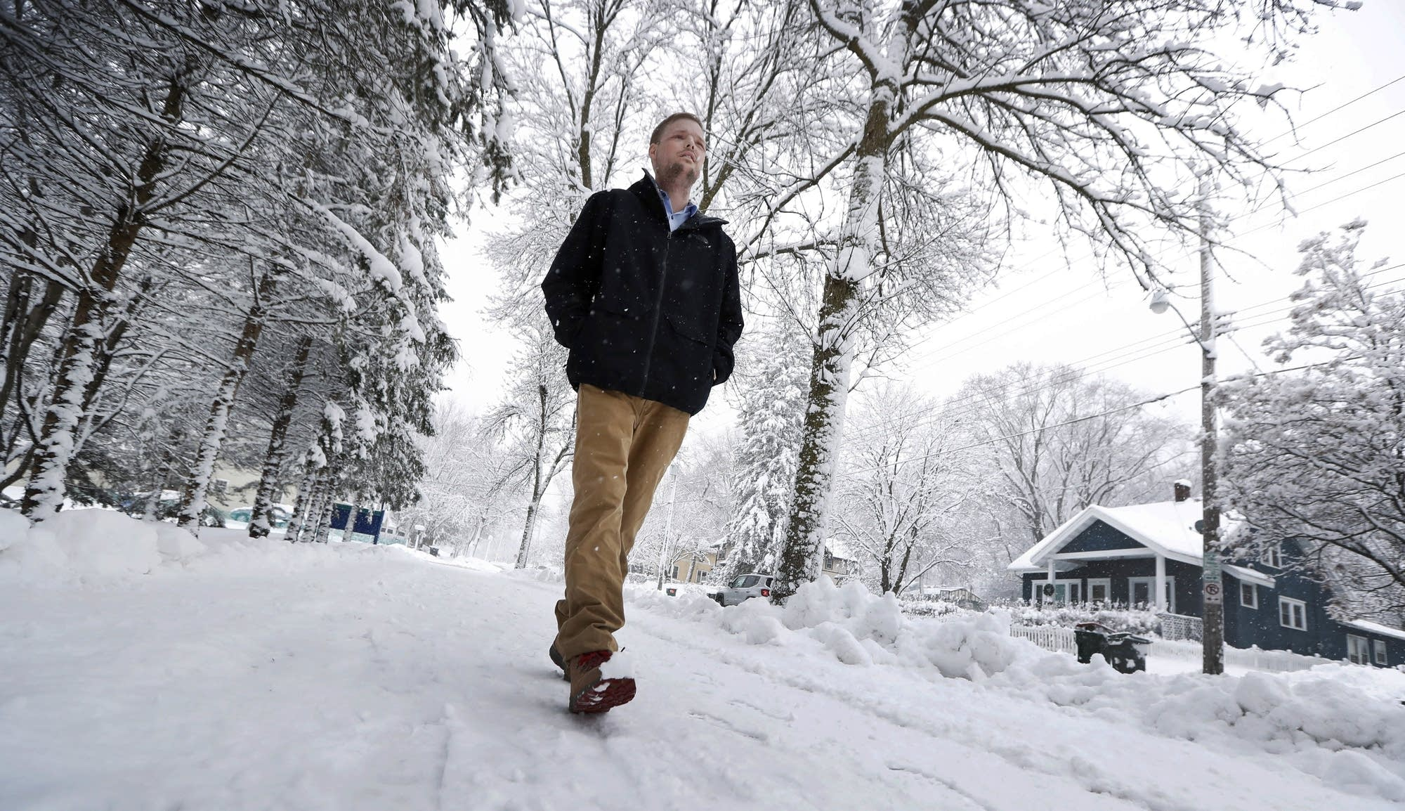 Andy Sandness walks to the Saint Marys Hospital campus at Mayo Clinic