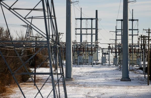 Transmission towers and power lines lead to a substation.