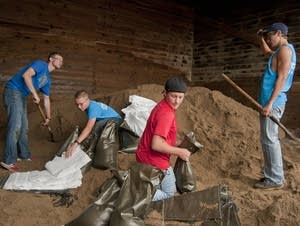 Filling sandbags in St. Clair