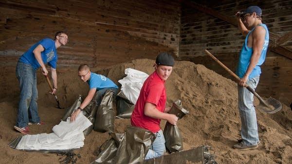 Filling sandbags in St. Clair