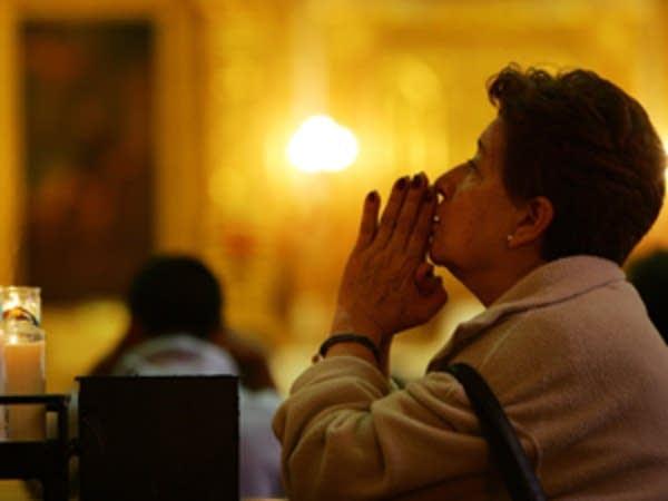 A woman prays