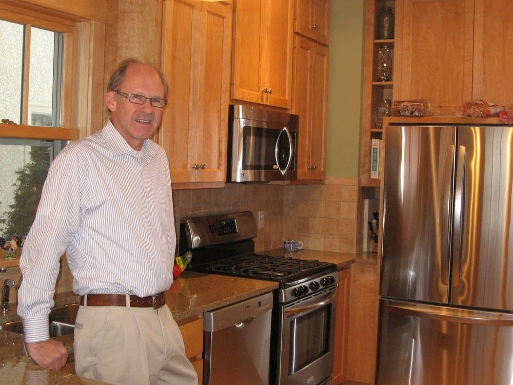 Keith Holtan stands at a recent remodeling job