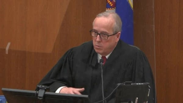 Judge Peter Cahill speaks