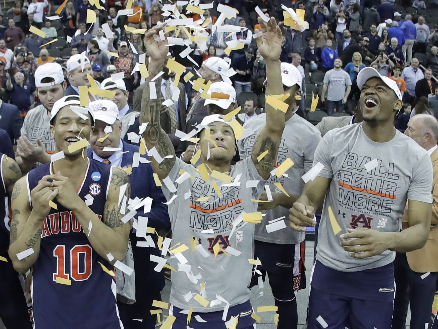 Auburn players celebrate after the Midwest Regional final game