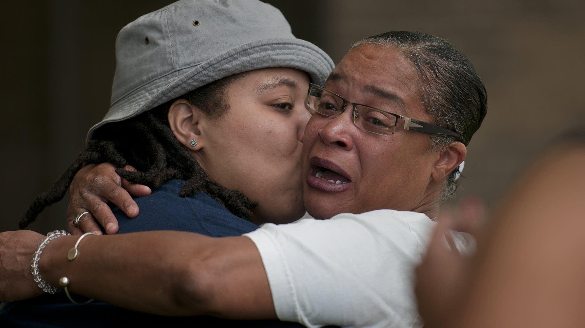 Jasmine Rockymore, left, shares a hug.