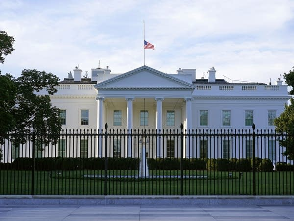 An American flag flies at half-staff over the White House