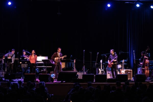 "The band performs ""Fortune Teller"" with Calexico"