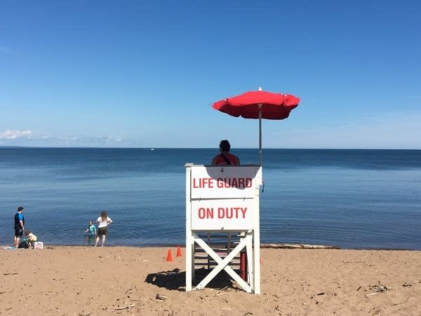 A lifeguard looks at the beach near the end of Park Point in Duluth.