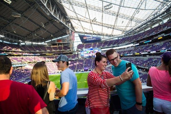 Fans take a selfie in US Bank Stadium