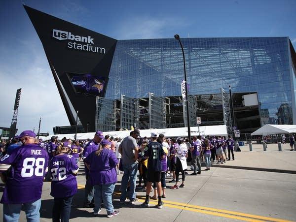 Fans line up to enter U.S. Bank Stadium