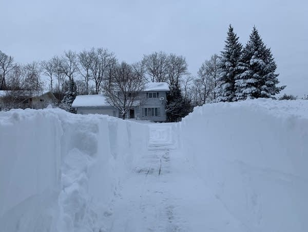 Drifts more than three feet high cover a driveway