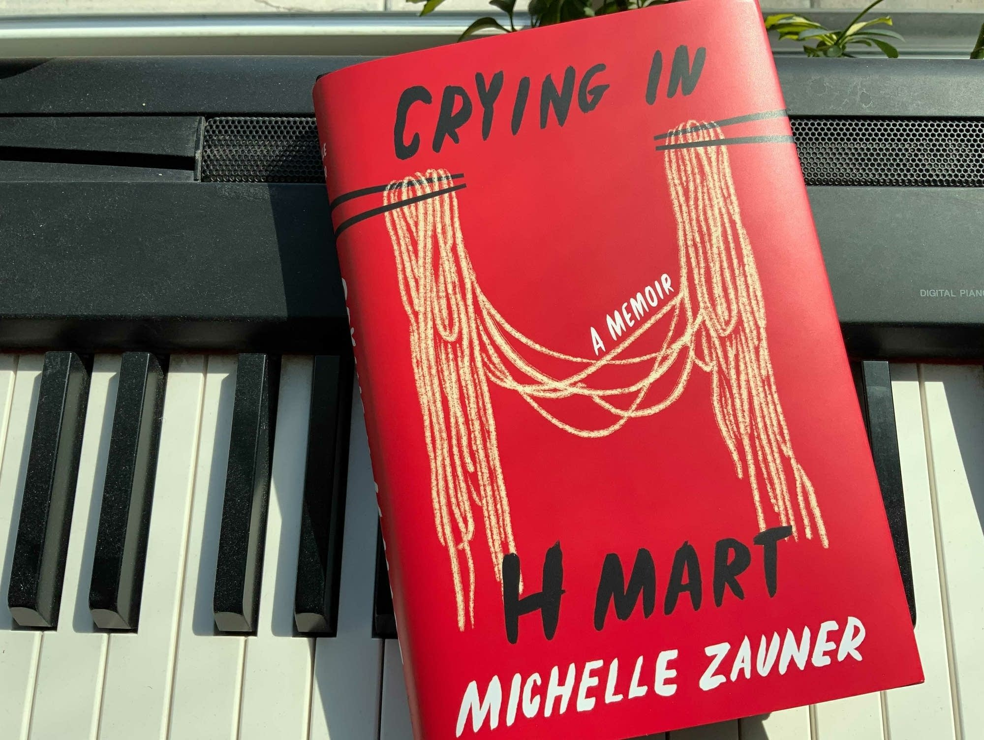 'Crying in H Mart' book resting on keyboard.
