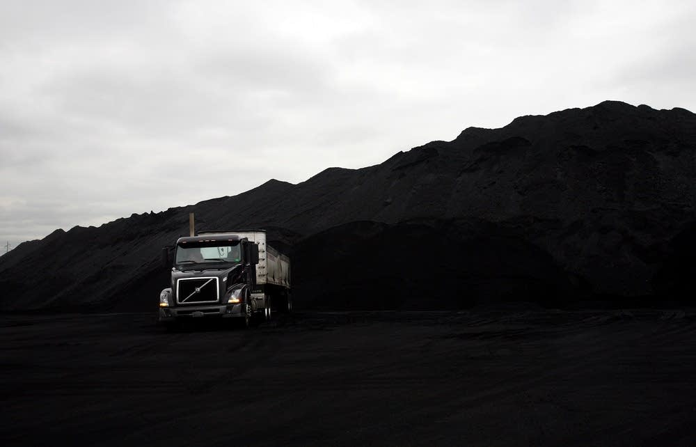 Loading trucks with petroleum coke