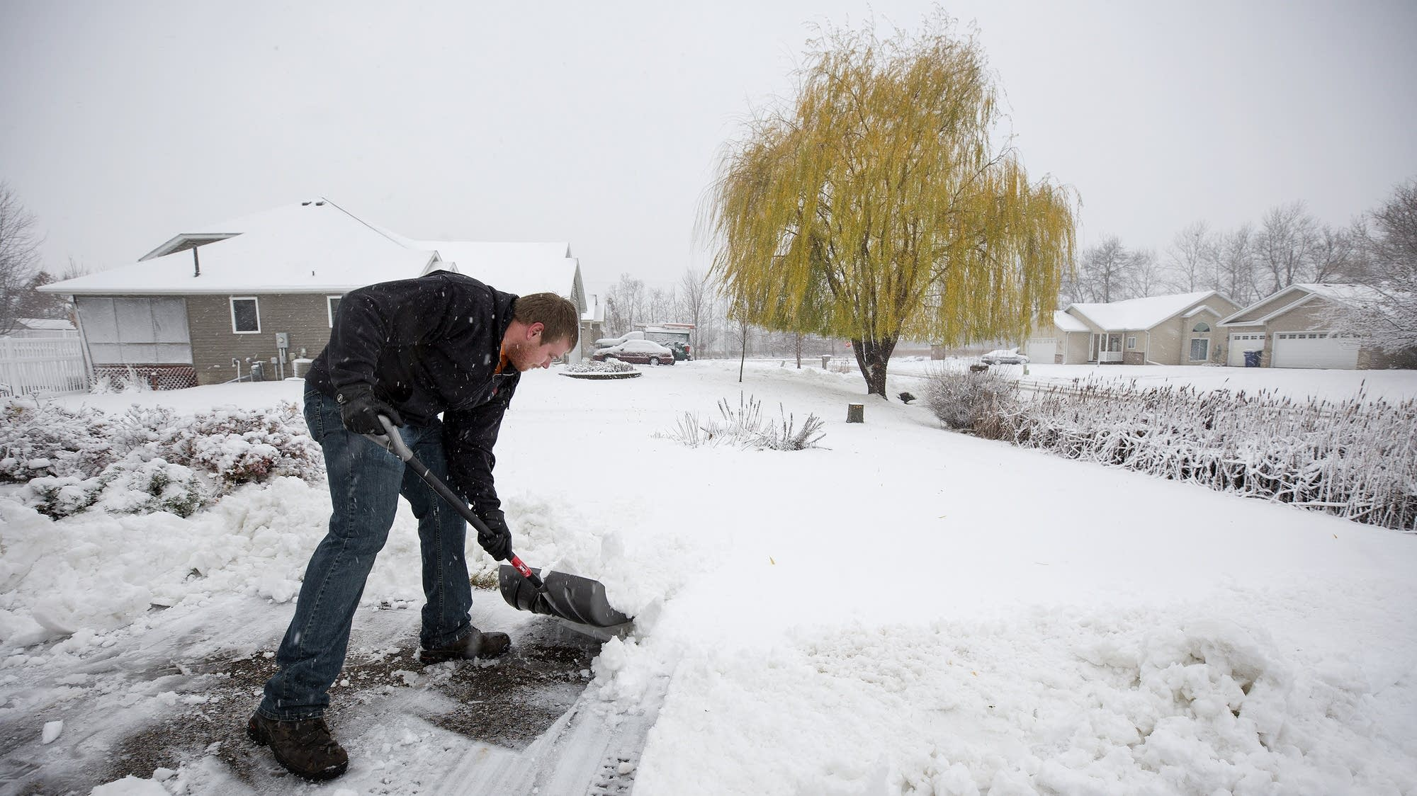 Joe Barthel shovels his driveway in St. Cloud.
