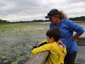 Monika Saxe watches as her nephew Lance Montminy fishes.