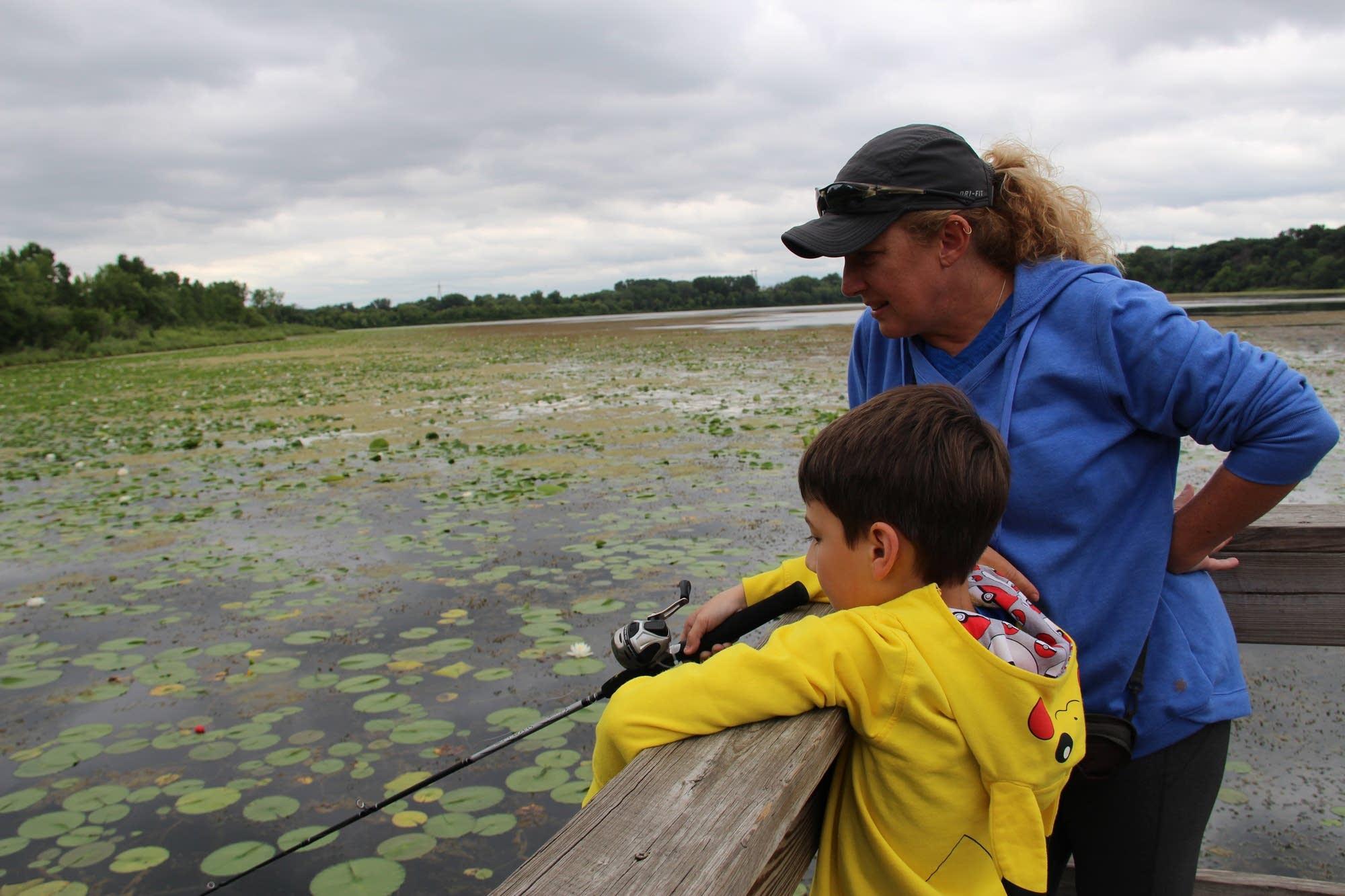 Monika Saxe watches as her nephew Lance Montminy fishes.