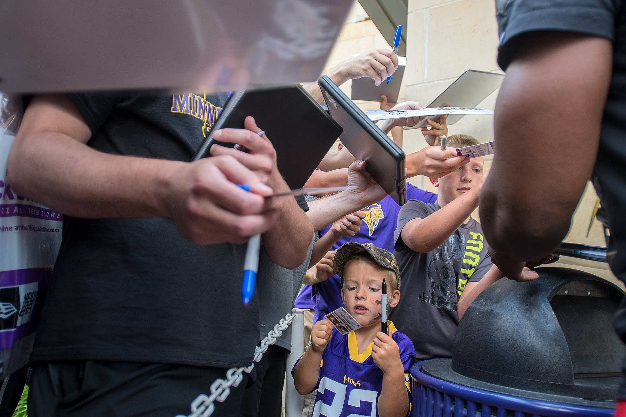 Russell Smith, 4, looks at a freshly signed autograph from Dalvin Cook.